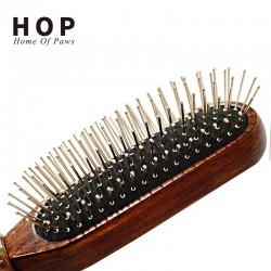 Wooden comb with metal teeth